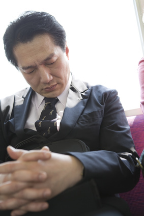 businessman having a nap in train